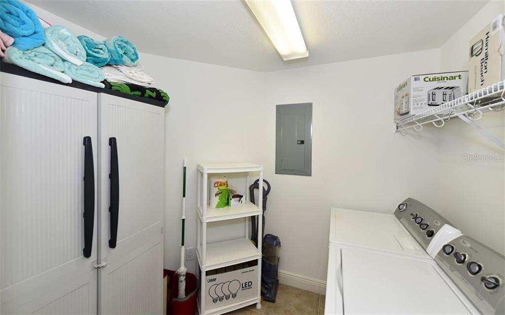 Laundry room with full size washer and dryer plus lots of storage space - Condo for sale at 800 N Tamiami Trl #602, Sarasota, FL 34236 - MLS Number is A4436915