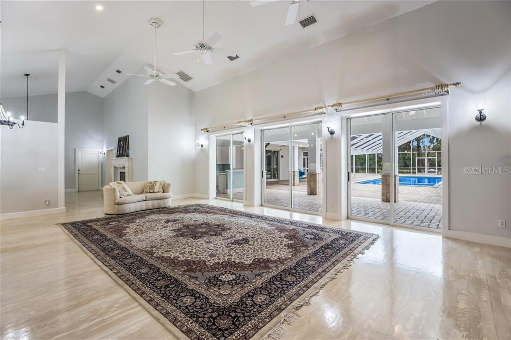 Magnificent sliders opening out to the expansive courtyard 40 x14 HTD pool/spa ! Lazy days poolside ! - Single Family Home for sale at 1810 21st St W, Palmetto, FL 34221 - MLS Number is A4438160