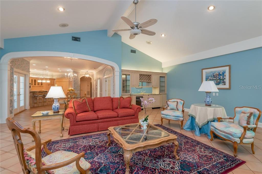 Arched entries, High ceilings, Recessed lighting, Built-in Cabinets and Wet Bar with wine racks, SubZero wine fridge (+ ice maker) are just some of the wonderful amenities of this estate! - Single Family Home for sale at 3702 Beneva Oaks Blvd, Sarasota, FL 34238 - MLS Number is A4438878