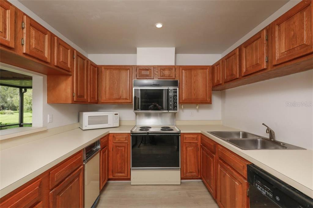 Kitchen pass through to dining room. - Condo for sale at 1742 Landings Blvd #38, Sarasota, FL 34231 - MLS Number is A4439252