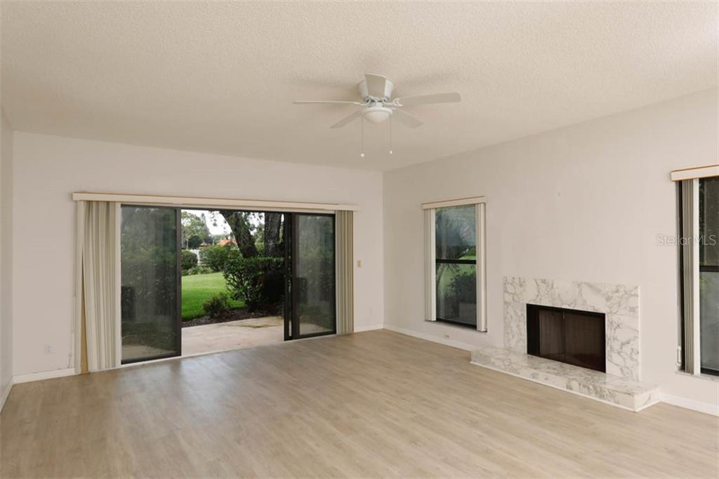 Living Room & fireplace. - Condo for sale at 1742 Landings Blvd #38, Sarasota, FL 34231 - MLS Number is A4439252