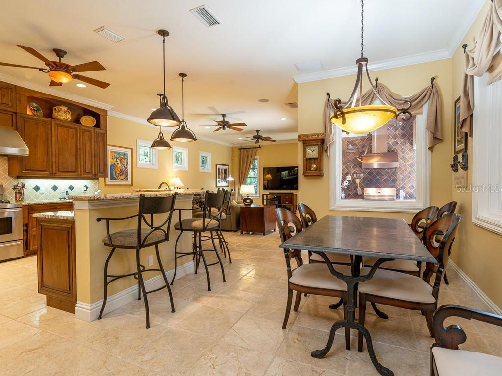Custom Alder Cabinets, Travertine floors, opens to lanai - Single Family Home for sale at 158 Puesta Del Sol, Osprey, FL 34229 - MLS Number is A4439362