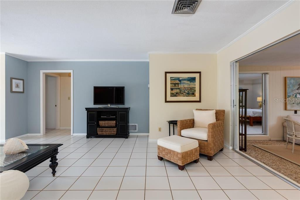 Lovingly maintained, walk into an open living dining area with views straight through to the canal out back. - Single Family Home for sale at 701 Norton St, Longboat Key, FL 34228 - MLS Number is A4440596