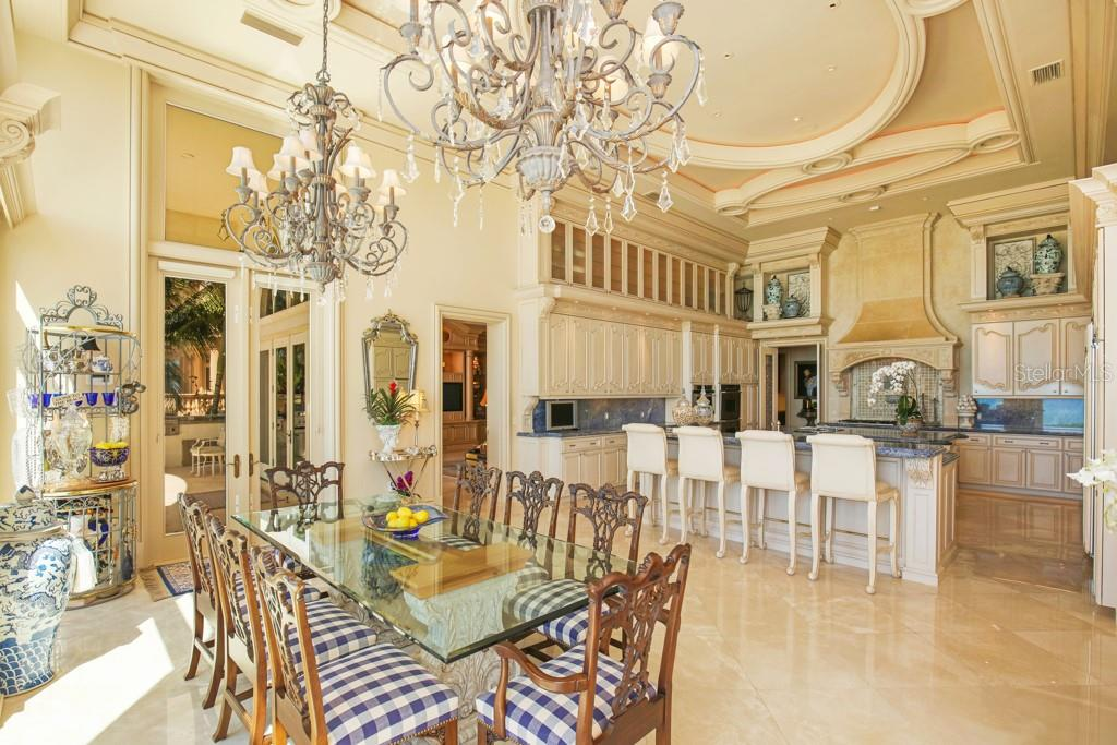 Family room with acess to the terrace - Single Family Home for sale at 845 Longboat Club Rd, Longboat Key, FL 34228 - MLS Number is A4440615