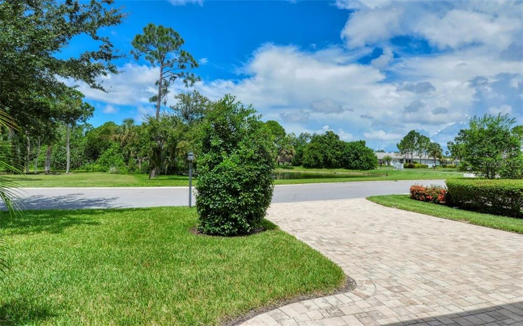 View across the street (Lake / Pond) - Single Family Home for sale at 1696 Lancashire Dr, Venice, FL 34293 - MLS Number is A4441325