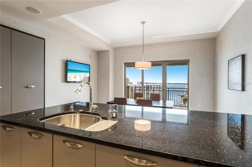 The kitchen overlooks the bay and has a beautiful view all the way to the gulf. - Condo for sale at 1111 Ritz Carlton Dr #1704, Sarasota, FL 34236 - MLS Number is A4442192
