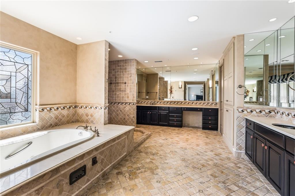 The master bath is very large and features two sinks, a soaking tub, spacious shower, and a walk-in closet. - Condo for sale at 1111 Ritz Carlton Dr #1704, Sarasota, FL 34236 - MLS Number is A4442192