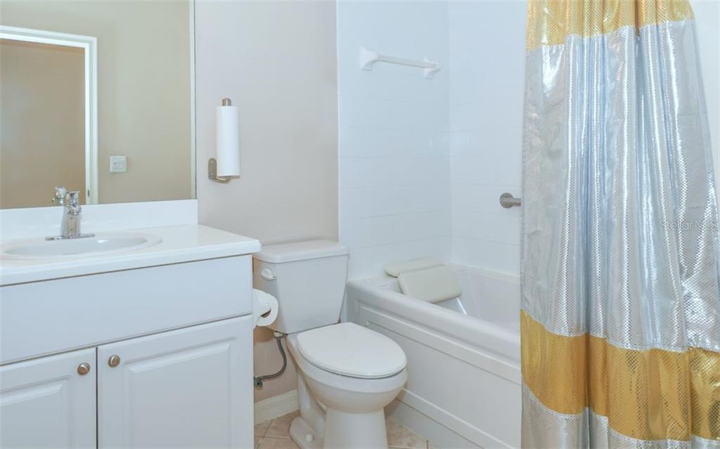 Guest bath with JETTED tub. - Single Family Home for sale at 114 Padova Way #52, North Venice, FL 34275 - MLS Number is A4442496