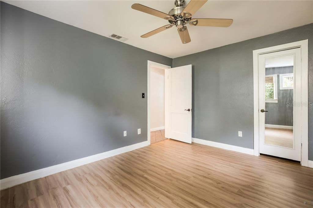 Second bedroom with new laminate flooring is perfect for a starter family or guests from out of town. - Single Family Home for sale at 1763 6th St, Sarasota, FL 34236 - MLS Number is A4442510