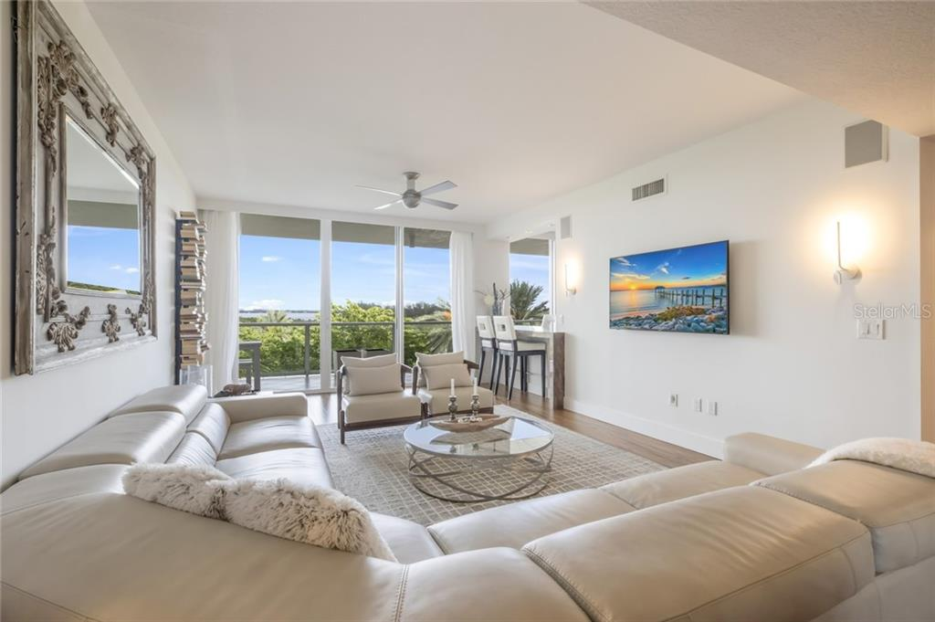 Open Living Room with Bay & City views. - Condo for sale at 1800 Benjamin Franklin Dr #b408, Sarasota, FL 34236 - MLS Number is A4444789