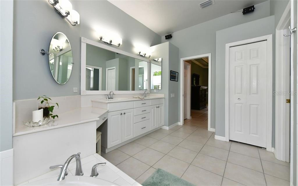 This side of the home offers the guest bath, 2nd bedroom with walk-in closet, & 3rd bedroom. Your guests will feel like family with a pocket door that makes this area a private suite. - Single Family Home for sale at 13022 Peregrin Cir, Bradenton, FL 34212 - MLS Number is A4444939