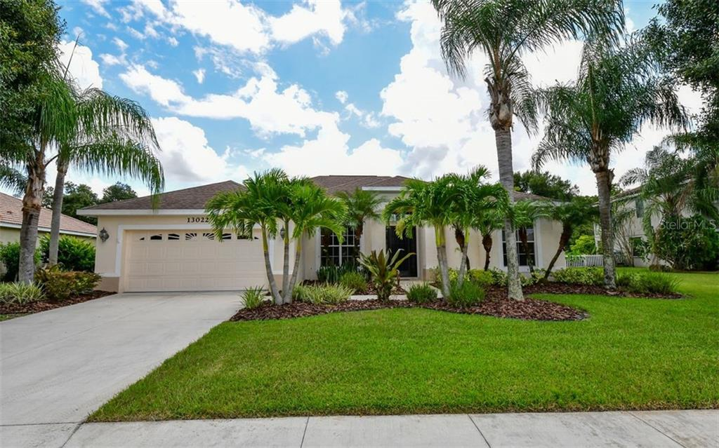 Rear of home - Single Family Home for sale at 13022 Peregrin Cir, Bradenton, FL 34212 - MLS Number is A4444939
