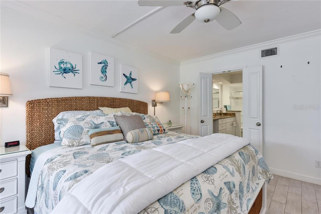 A rare treat in a condo is a laundry room with a full size washer and dryer! - Condo for sale at 501 Gulf Dr N #305, Bradenton Beach, FL 34217 - MLS Number is A4445601