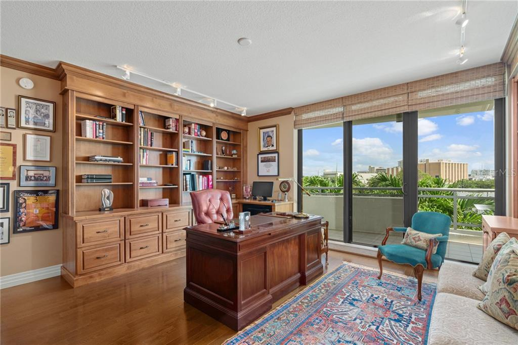Guest Bedroom | Currently being utilized as a study, the room is large and bright with access to the guest terrace.  2 walls of custom cabinetry afford ample amounts of storage. - Condo for sale at 401 S Palm Ave #402, Sarasota, FL 34236 - MLS Number is A4446224
