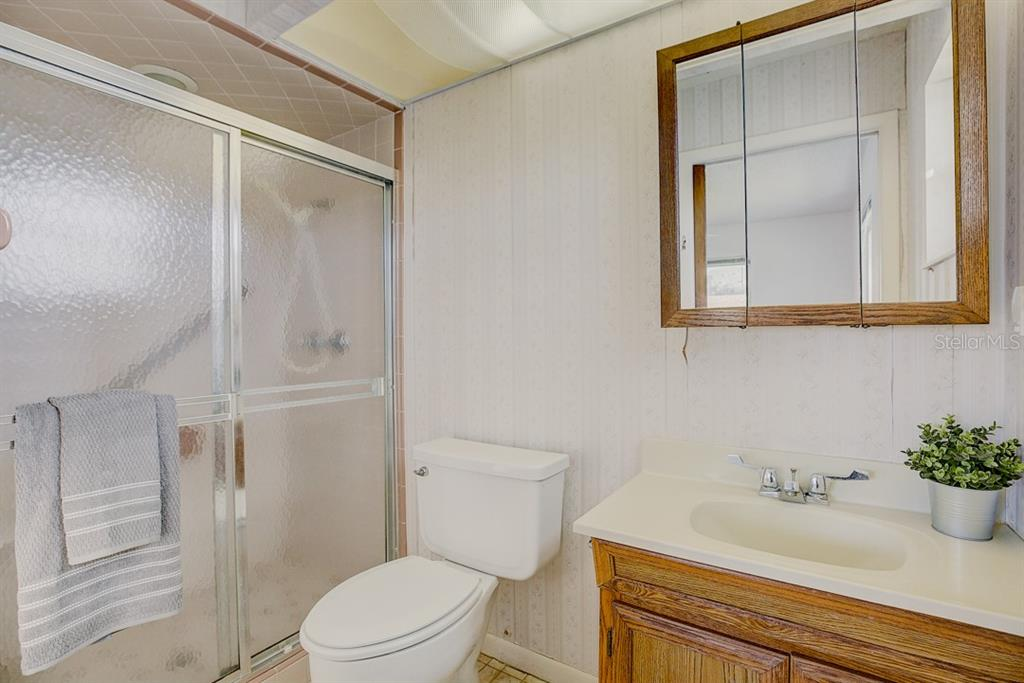 Ensuite Bathroom - Single Family Home for sale at 523 67th St, Holmes Beach, FL 34217 - MLS Number is A4447854
