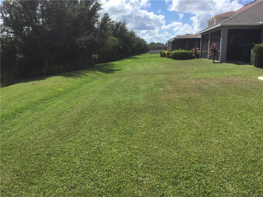 Back yard - Single Family Home for sale at 5727 Arbor Wood Ct, Bradenton, FL 34203 - MLS Number is A4448047