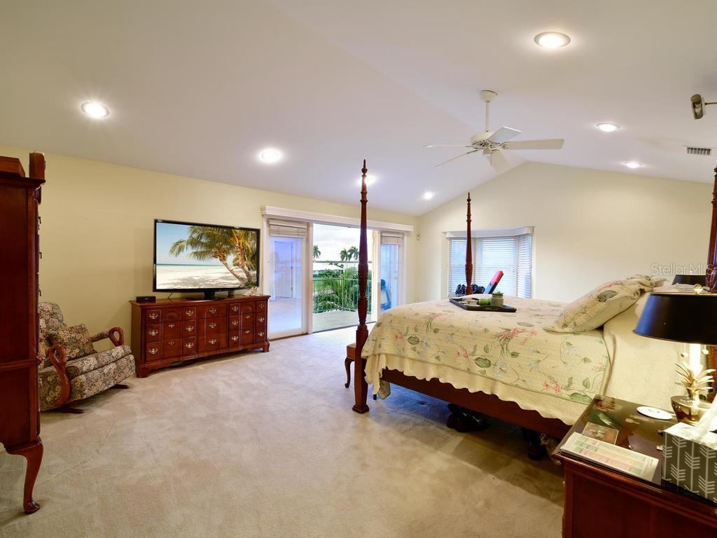 Second Floor Master Suite with Private balcony overlooking the salt water canal - Single Family Home for sale at 2008 72nd St Nw, Bradenton, FL 34209 - MLS Number is A4450238
