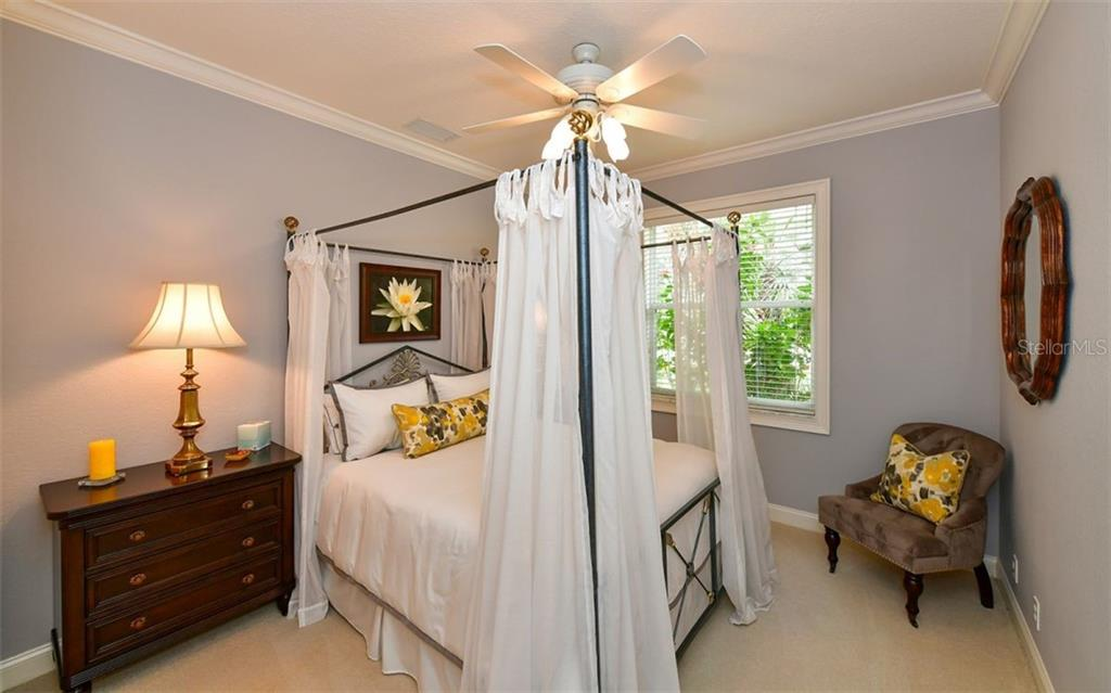 Bedroom 3 - Single Family Home for sale at 574 N Macewen Dr, Osprey, FL 34229 - MLS Number is A4455085
