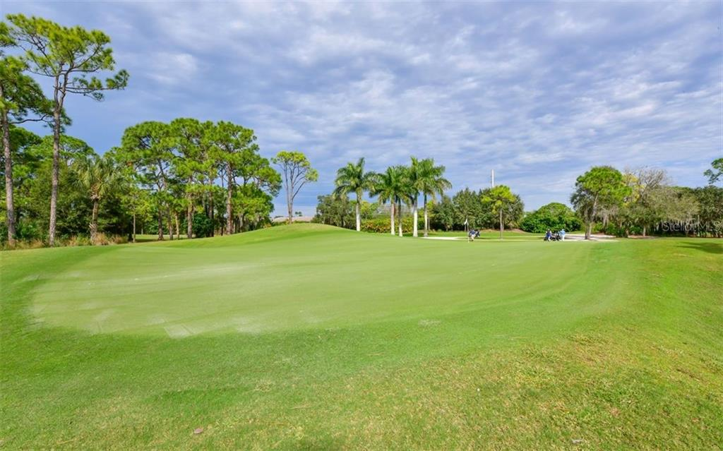 View of golf course - Single Family Home for sale at 574 N Macewen Dr, Osprey, FL 34229 - MLS Number is A4455085