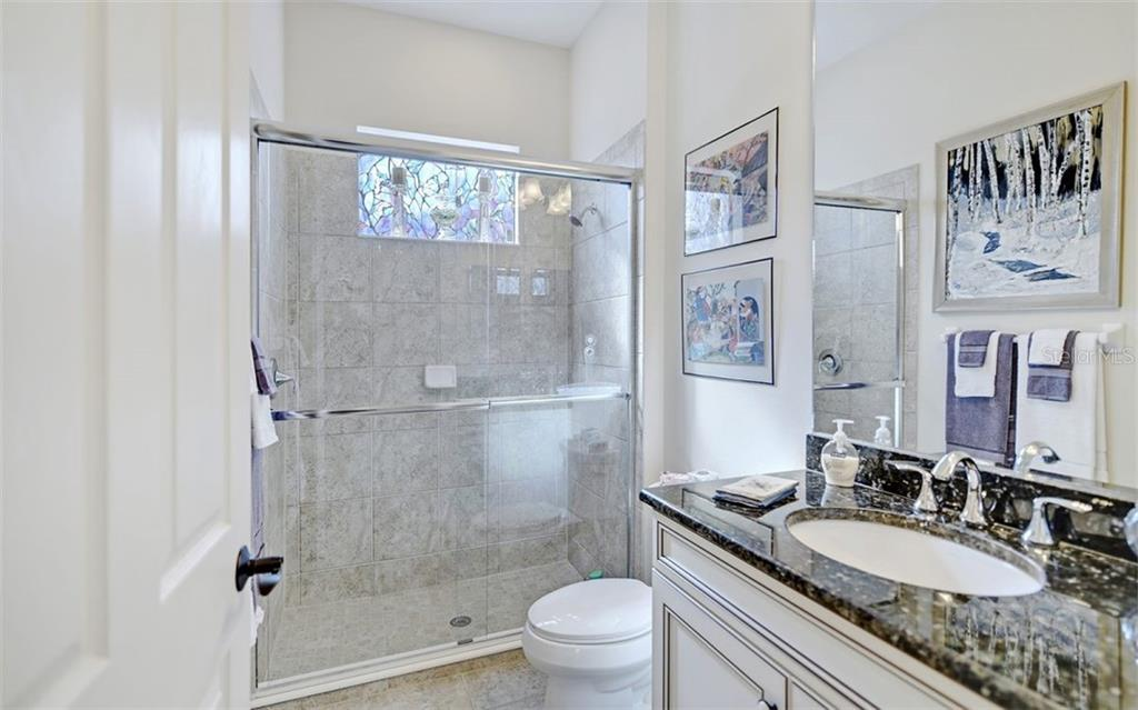Bathroom 3 also functions as a pool bath...just steps to outdoor living space - Single Family Home for sale at 8260 Larkspur Cir, Sarasota, FL 34241 - MLS Number is A4455087
