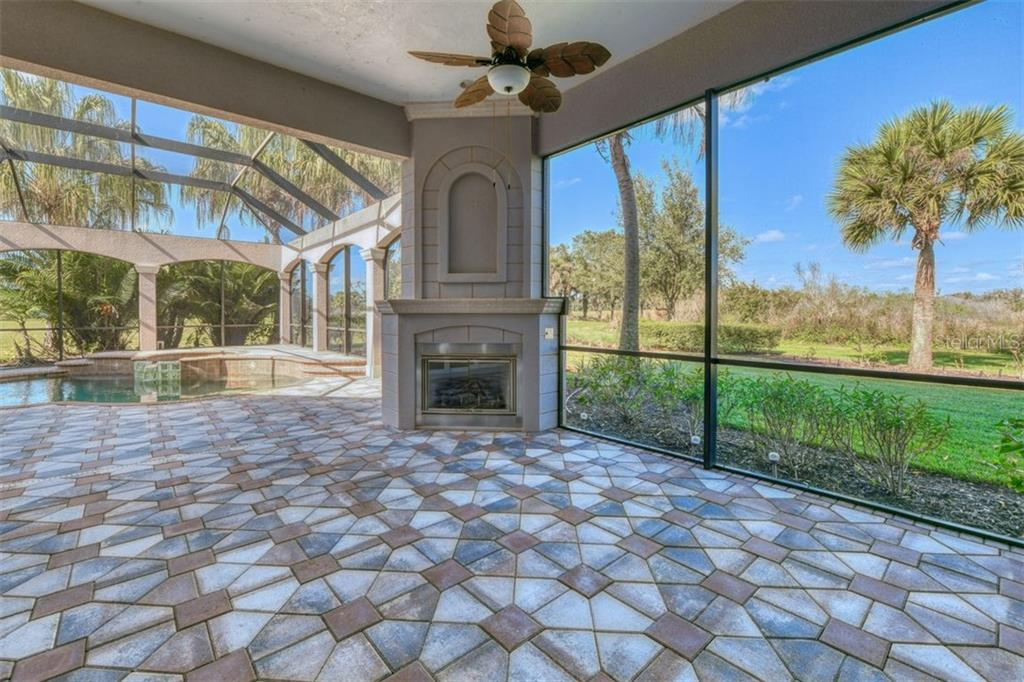 Lanai and fireplace - Single Family Home for sale at 3719 Founders Club Dr, Sarasota, FL 34240 - MLS Number is A4455099