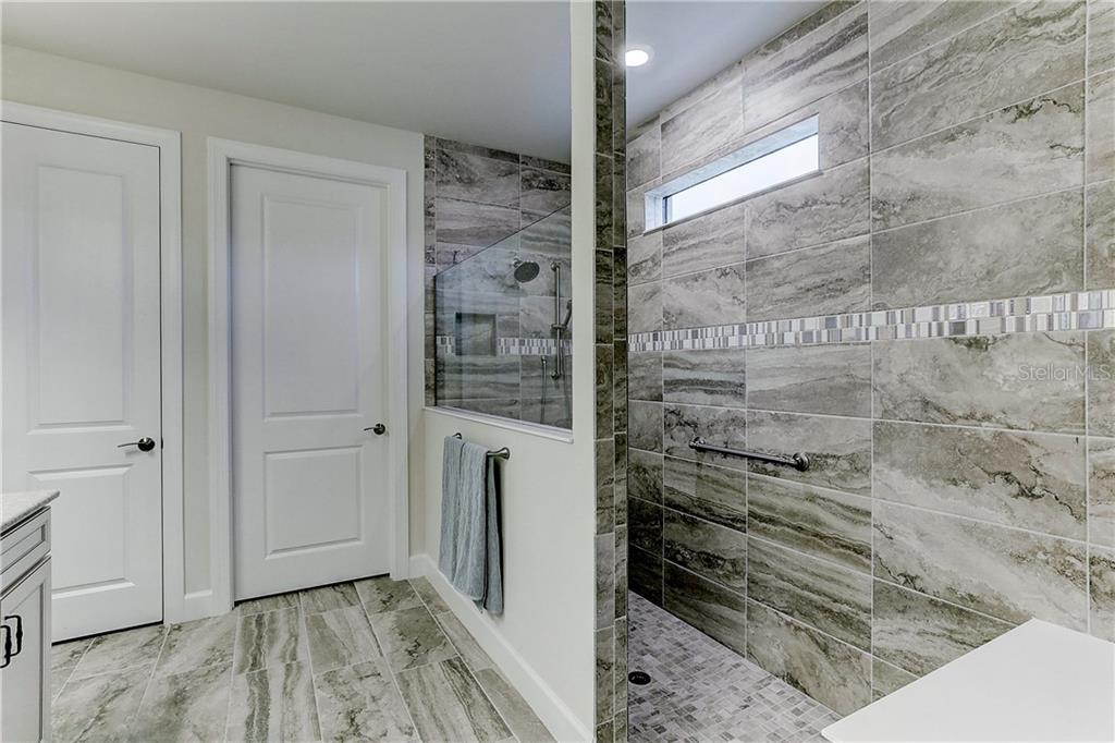 Large Walk-in shower in Master Bath with Spa Shower System - Single Family Home for sale at 6859 Chester Trl, Lakewood Ranch, FL 34202 - MLS Number is A4458594