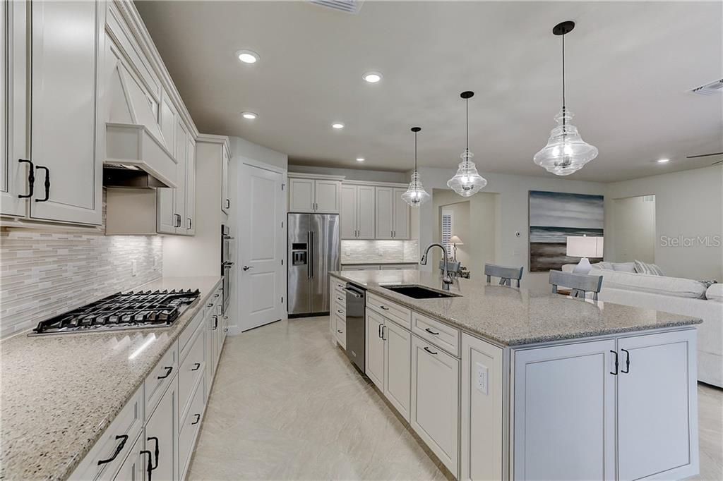 Large Gourmet Kitchen with Quartz Countertops - Single Family Home for sale at 6859 Chester Trl, Lakewood Ranch, FL 34202 - MLS Number is A4458594