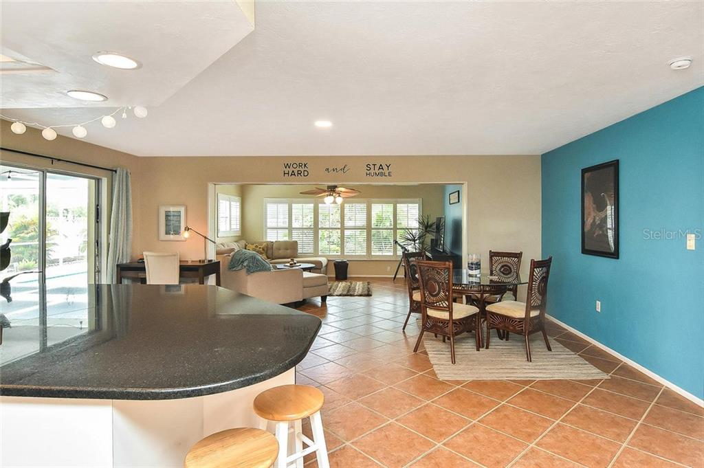 Breakfast bar, dinette to family room - Single Family Home for sale at 1758 Croton Dr, Venice, FL 34293 - MLS Number is A4459877