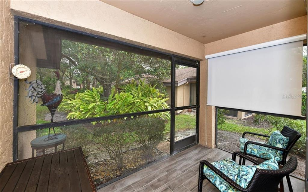Enclosed lanai with privacy screen for early morning sun-the view is peaceful and serene! - Condo for sale at 4613 Morningside #30, Sarasota, FL 34235 - MLS Number is A4460777