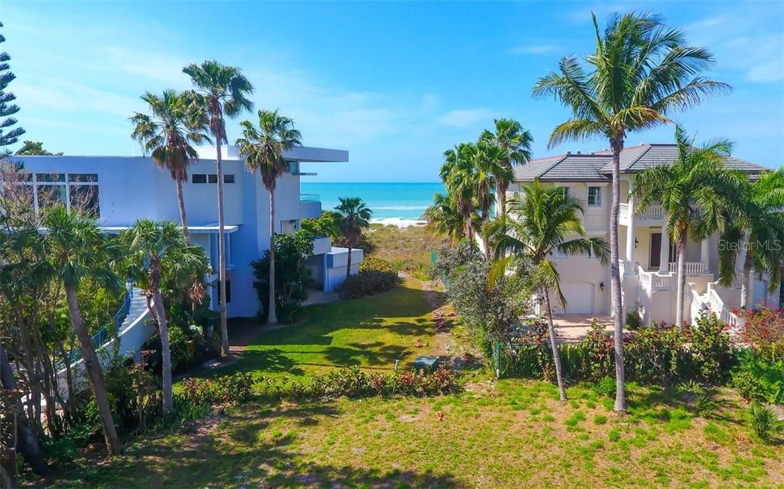 Shows west end of lot and deeded pathway to the beach.  Path to the beach between the 2 houses on the north and south of the lot. - Vacant Land for sale at 5809 Gulf Of Mexico Dr, Longboat Key, FL 34228 - MLS Number is A4460950