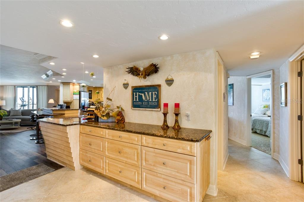 EXTRA storage in the foyer area - Condo for sale at 5880 Midnight Pass Rd #911, Sarasota, FL 34242 - MLS Number is A4462559