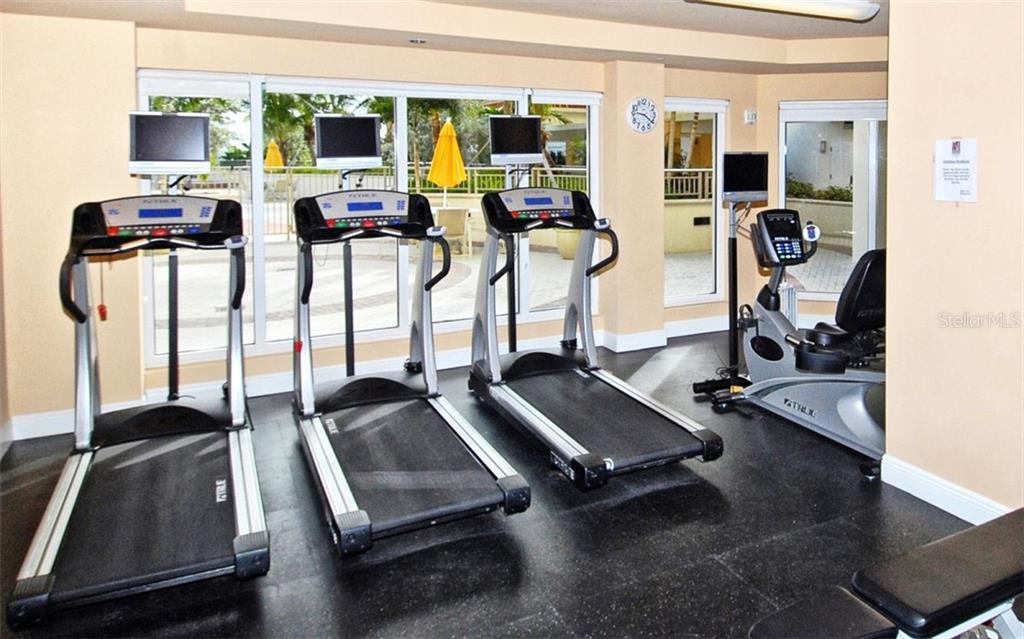 Fitness center overlooks the pool deck - Condo for sale at 100 Central Ave #A401, Sarasota, FL 34236 - MLS Number is A4463296