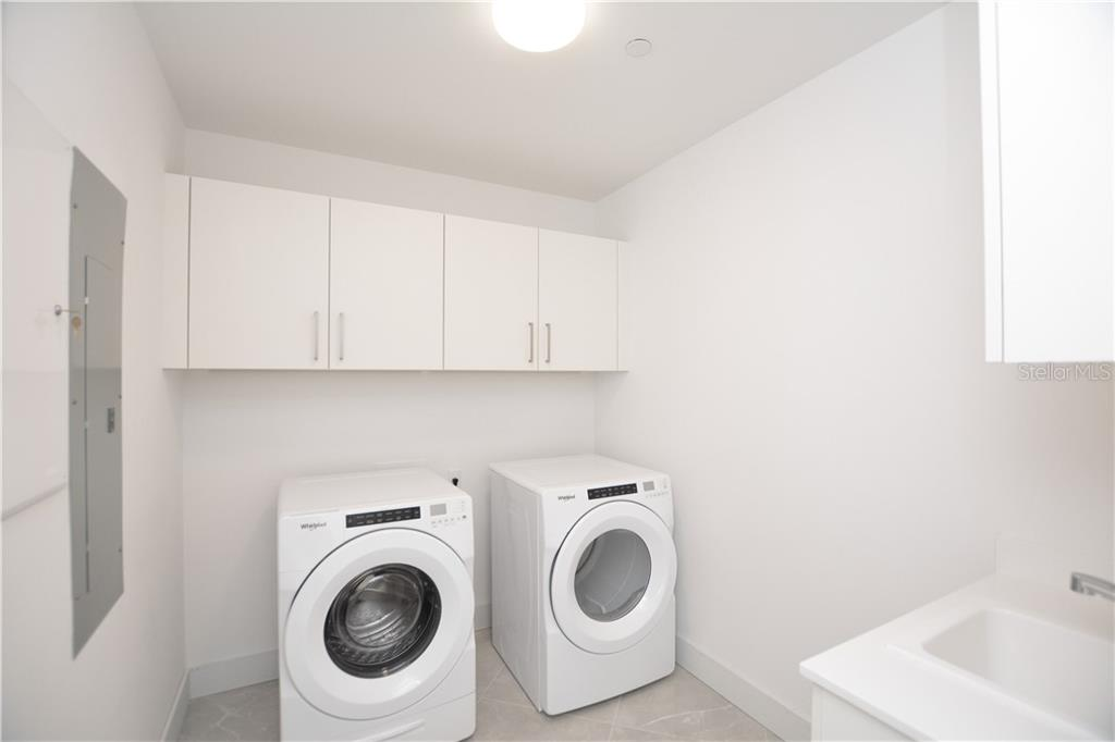 Large in-unit laundry room with utility sink, full size washer & dryer and extra storage. - Condo for sale at 111 S Pineapple Ave #610, Sarasota, FL 34236 - MLS Number is A4463717