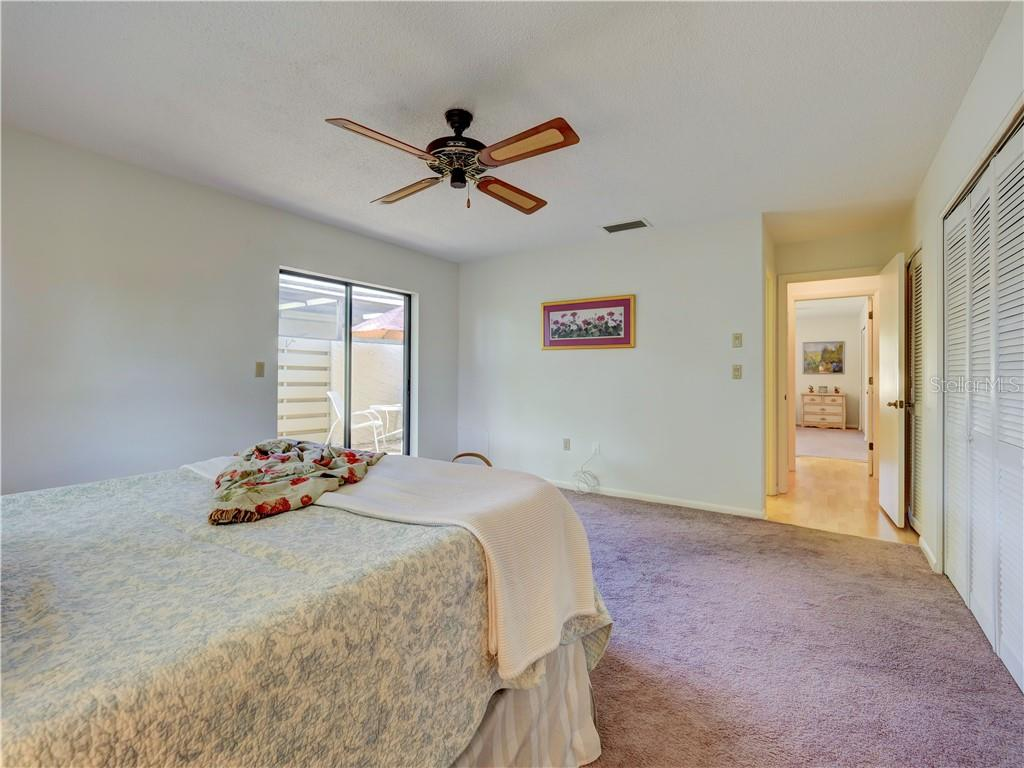 Master Bedroom with sliding doors which lead  to Enclosed Courtyard - Villa for sale at 4335 Rum Cay Cir, Sarasota, FL 34233 - MLS Number is A4463762