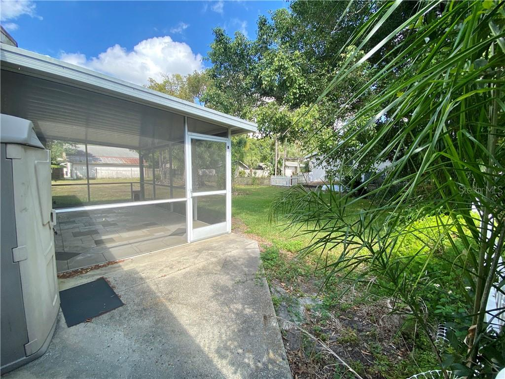 Paved path to the lanai. - Single Family Home for sale at 4300 Eastern Pkwy, Sarasota, FL 34233 - MLS Number is A4464200
