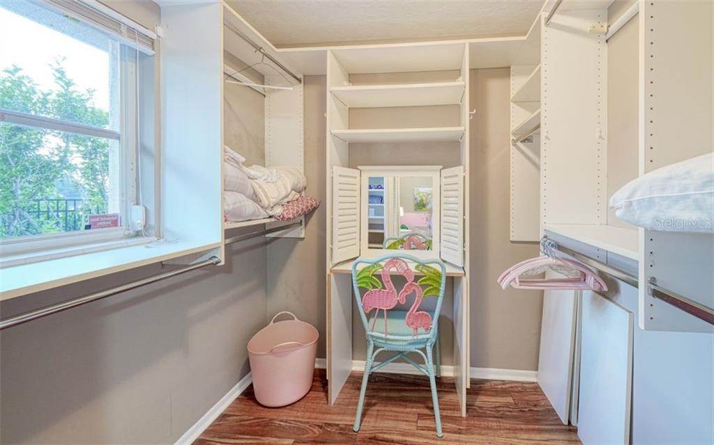 LIGHT & BRIGHT CUSTOM CLOSET WITH A VANITY AREA - Single Family Home for sale at 3 Winslow Pl, Longboat Key, FL 34228 - MLS Number is A4464990