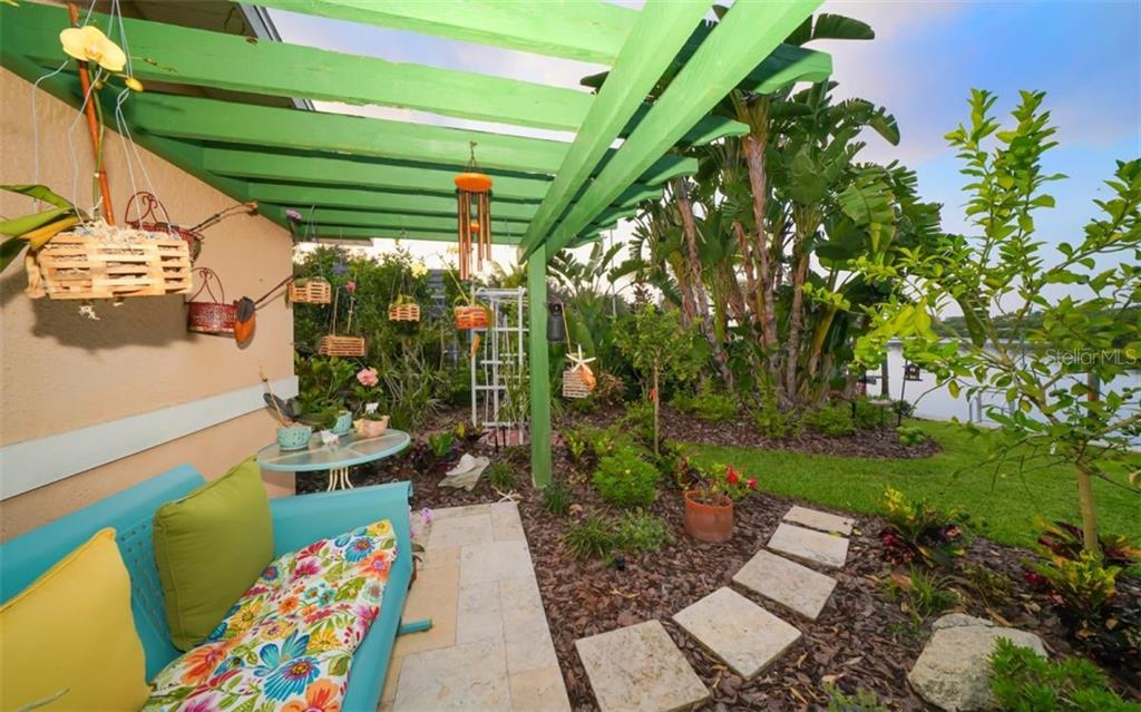 SO RELAXING & PEACEFUL - Single Family Home for sale at 3 Winslow Pl, Longboat Key, FL 34228 - MLS Number is A4464990