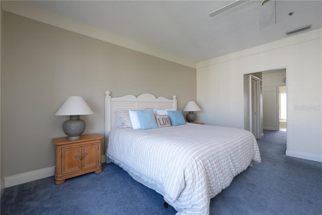 Bedroom to closets and master bath. - Condo for sale at 515 Forest Way, Longboat Key, FL 34228 - MLS Number is A4465231