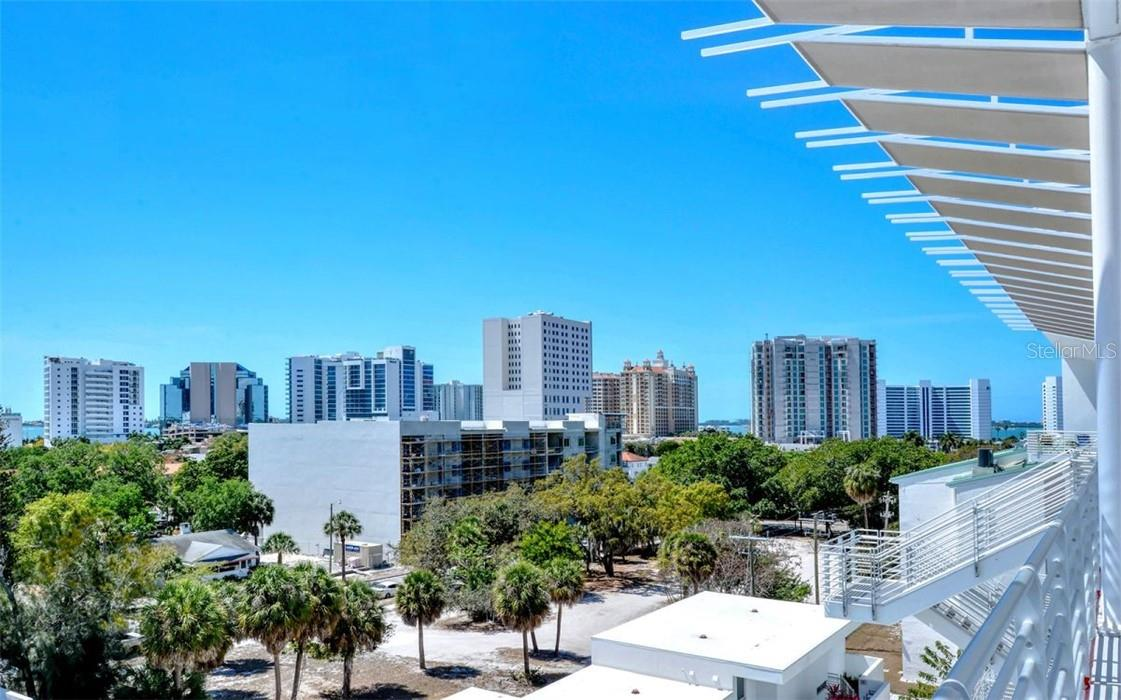 The roof top amenity allows you to enjoy the city skyline views to the west and observe the sunset glow along the abundant architecture and to Sarasota Bay. - Condo for sale at 1350 5th Street #301, Sarasota, FL 34236 - MLS Number is A4466172