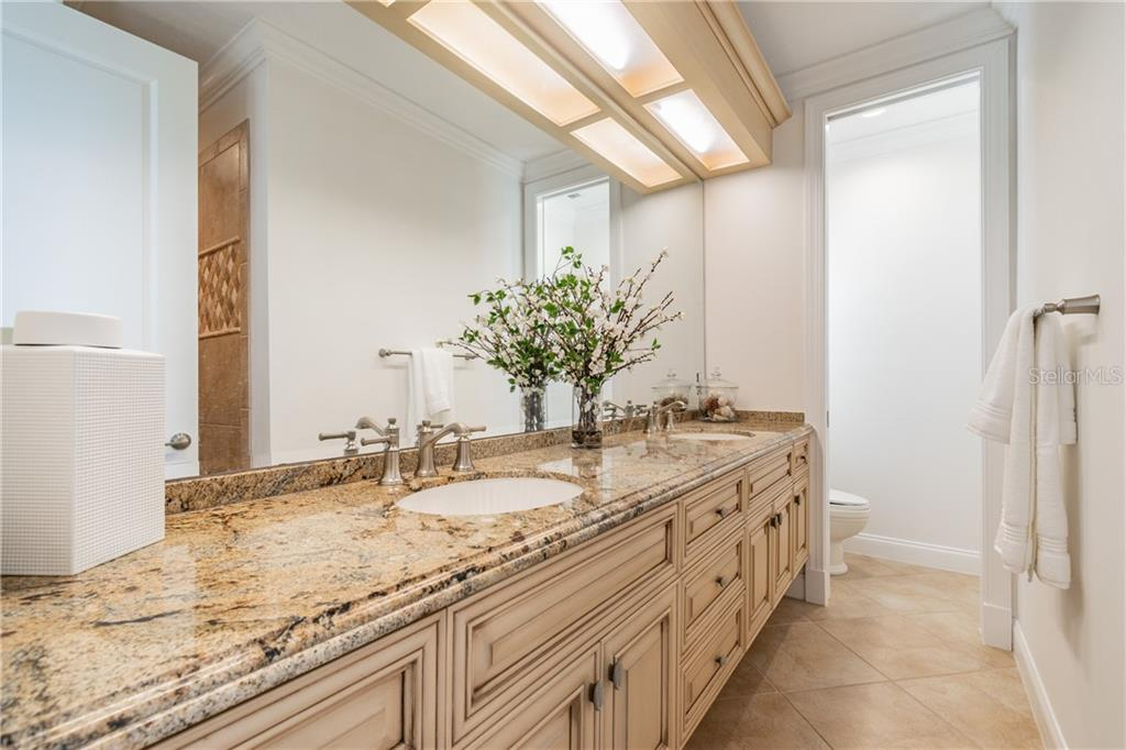 En suite bath with shower for Bedroom 2 - Single Family Home for sale at 1418 John Ringling Pkwy, Sarasota, FL 34236 - MLS Number is A4467093