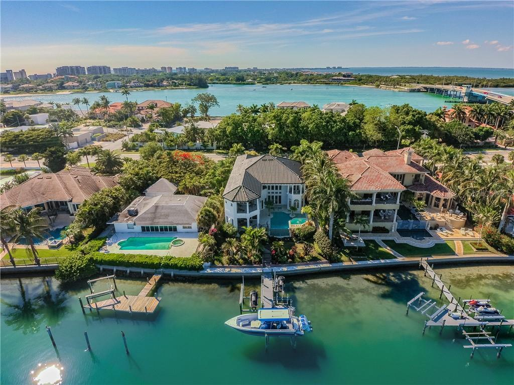 Middle house/dark roof with boat on lift - Single Family Home for sale at 1418 John Ringling Pkwy, Sarasota, FL 34236 - MLS Number is A4467093