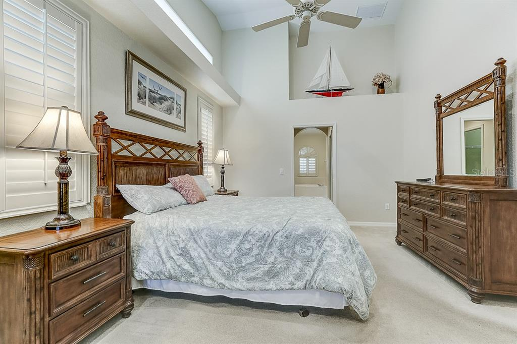 Bedroom to master bath - Single Family Home for sale at 4338 Corso Venetia Blvd, Venice, FL 34293 - MLS Number is A4467578