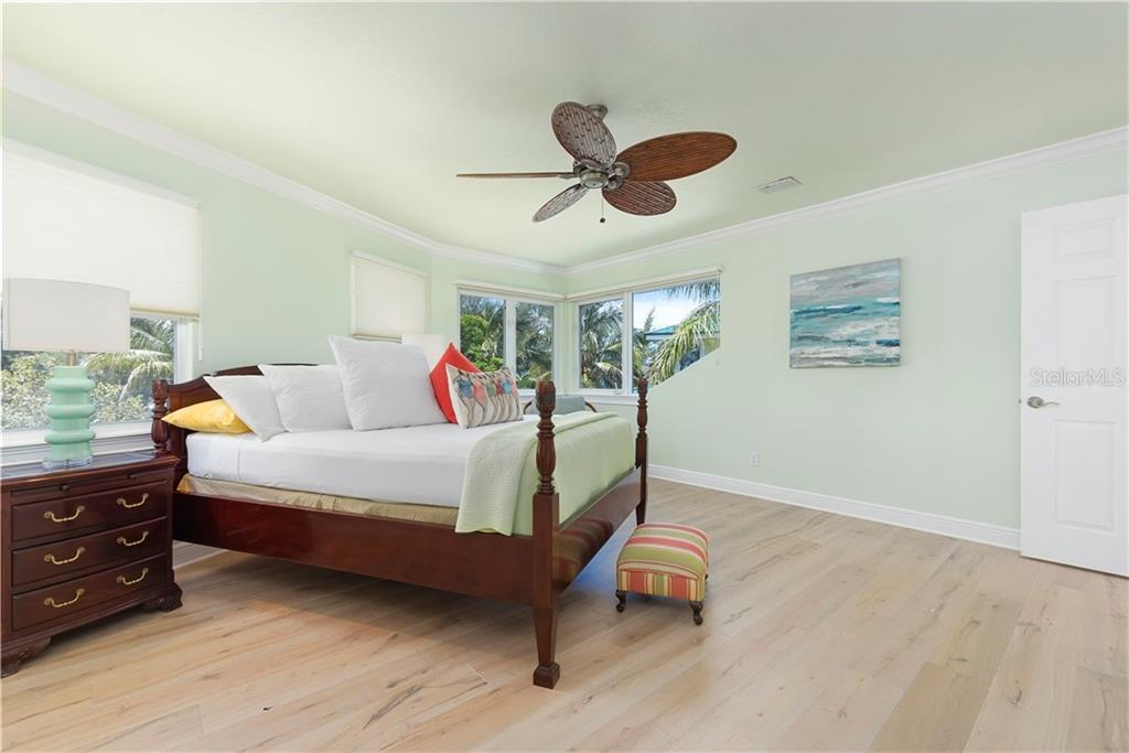 Master en suite with hardwood flooring - Single Family Home for sale at 97 52nd St, Holmes Beach, FL 34217 - MLS Number is A4468151