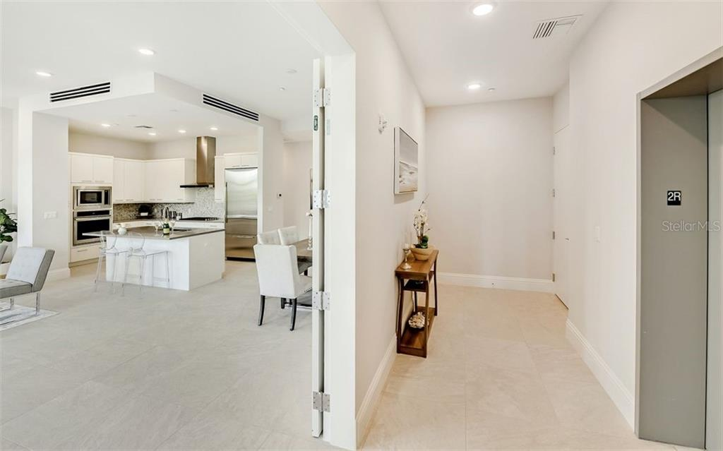 The key-less elevator drops you at your private foyer and your double-door entryway. - Condo for sale at 609 Golden Gate Pt #201, Sarasota, FL 34236 - MLS Number is A4468917