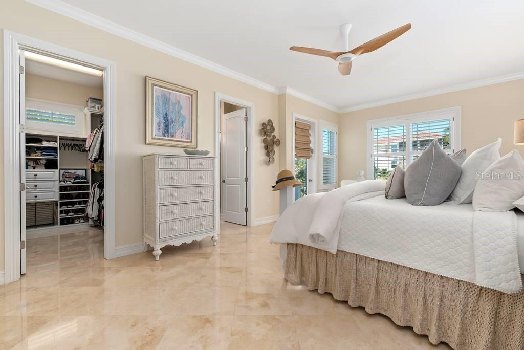 Downstairs Master bedroom, walk in closet, bath and private patio - Single Family Home for sale at 605 N Point Dr, Holmes Beach, FL 34217 - MLS Number is A4469001