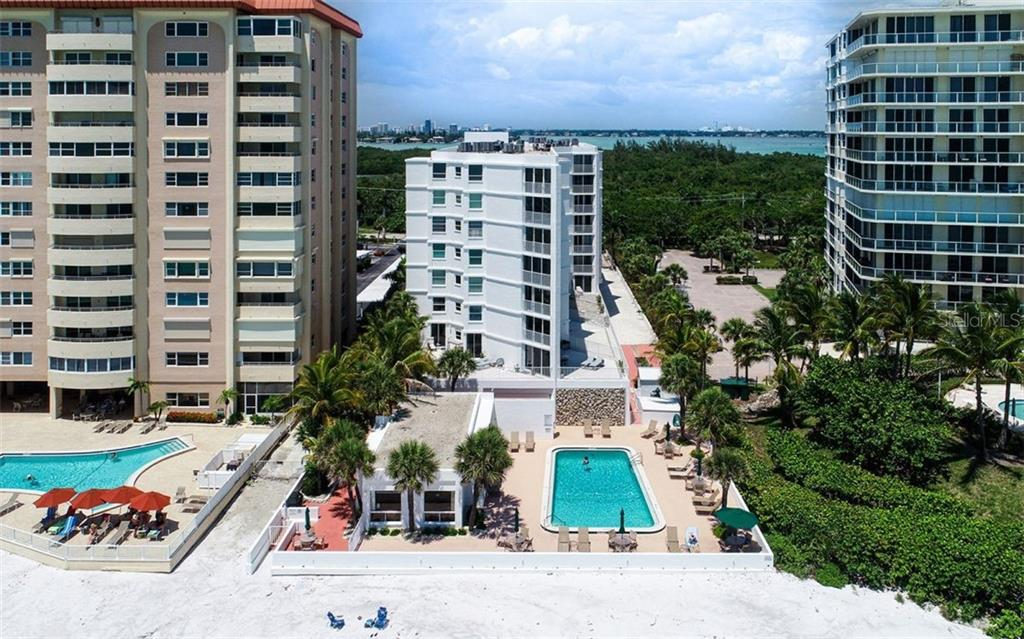 Beachfront pool and clubhouse. - Condo for sale at 1770 Benjamin Franklin Dr #706, Sarasota, FL 34236 - MLS Number is A4469463