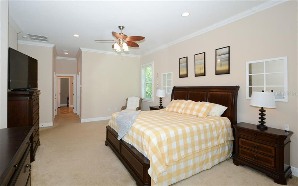 Master bedroom features large custom designed closet, linen closet, and private en-suite - Single Family Home for sale at 1623 Jacana Ct, Nokomis, FL 34275 - MLS Number is A4470679