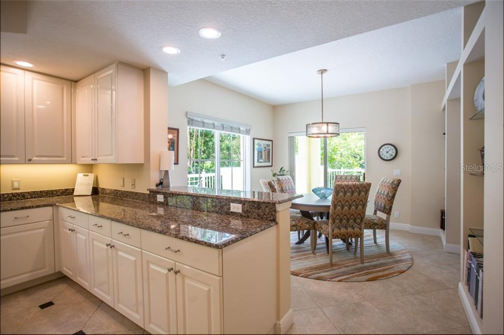 Breakfast bar and dining area - Condo for sale at 1308 Old Stickney Point Rd #W24, Sarasota, FL 34242 - MLS Number is A4471155