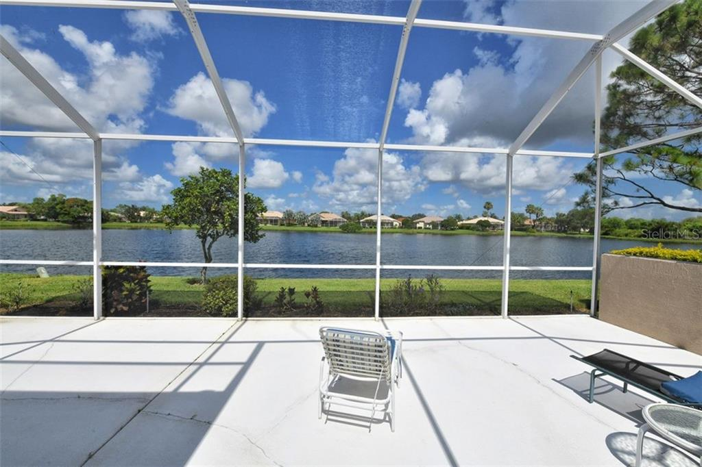 Beautiful panorama of the lake and a western exposure. - Villa for sale at 4590 Samoset Dr, Sarasota, FL 34241 - MLS Number is A4471881