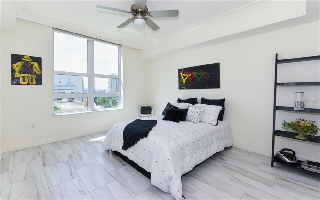 Master bedroom with porcelain tile - Condo for sale at 1350 Main St #701, Sarasota, FL 34236 - MLS Number is A4472236